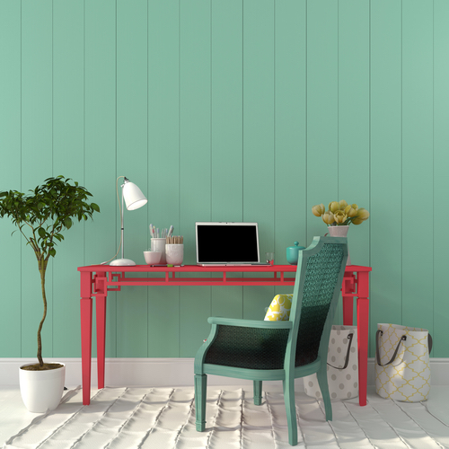 Interior of a home office of a pink desk and a turquoise chair